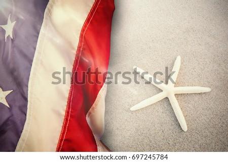 Flare against starfish kept on sand #697245784