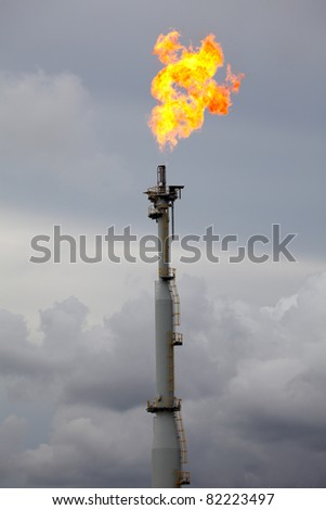 Flare burning gas at refinery plant
