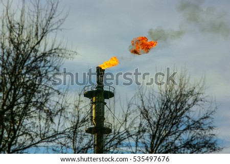 Flare stack of an oil refinery plant #535497676