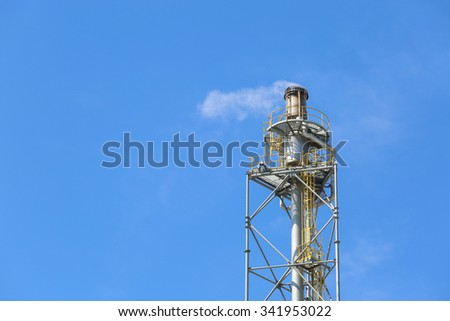 Flare stack with blue sky #341953022