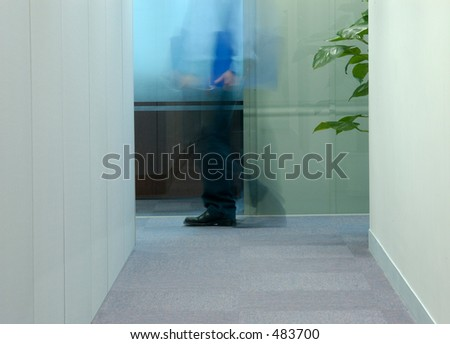Flash blur employee walking in the office - stock photo