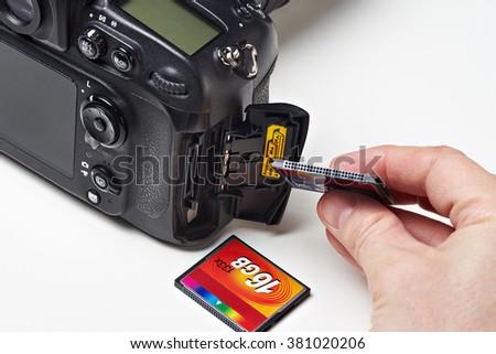 Flash card CF and DSLR camera close-up