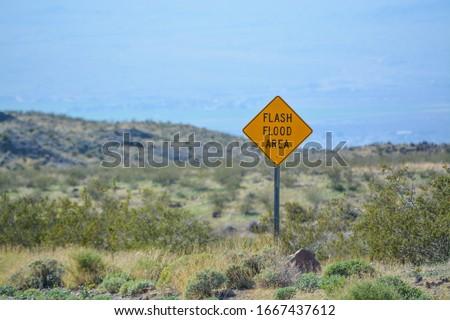 Flash Flood Area Sign in the Sonoran Desert, Arizona USA  Stock photo ©