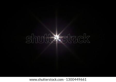 Flash light effect isolated on transparent background. White flashlight, flare or camera flash overlay