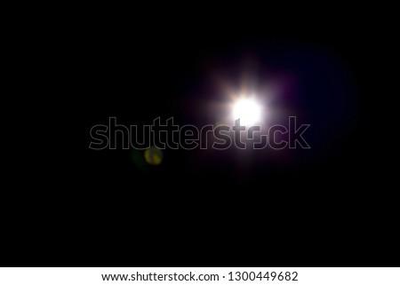 Flash light effect isolated on transparent background. White flashlight, flare or camera flash overlay #1300449682