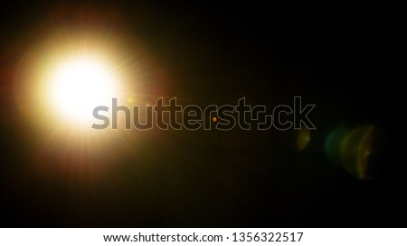 Flash of a distant abstract star. Abstract sun flare. The lens flare is subject to digital correction. - Image #1356322517