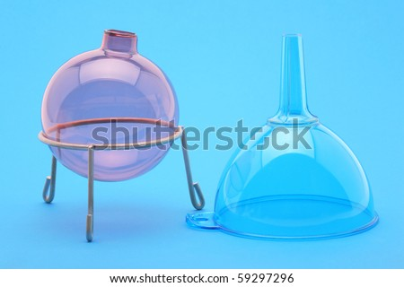 Flask and funnel on a blue background in laboratory