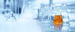 flask and glassware equipment in chemistry science laboratory blue banner background
