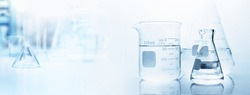 flask with clear beaker and glassware in medical science lab banner background