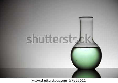 flask with green liquid and white background