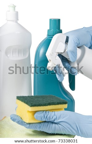 flasks of products of cleaning with hands with gloves and scouring pad