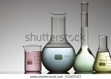 flasks with colored liquid and a white background