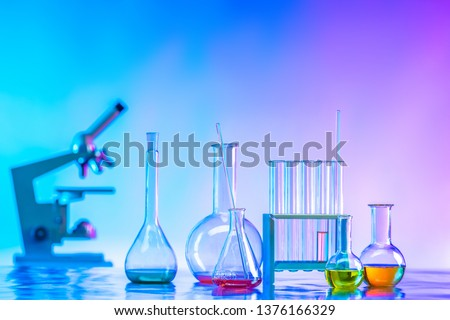 Flasks with reagents. Laboratory glassware. Medical glass flasks. Chemical laboratory. Laboratory diagnostics. Chemical analysis. Biochemistry. Pharmacology.