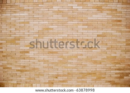 flat and simple brown brick wall background texture with a vignette