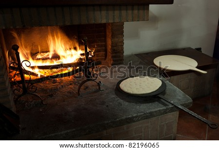 Flat bread ready for cooking traditional Italian style, in Barcomonte agriturismo, Gubbio, Italy.