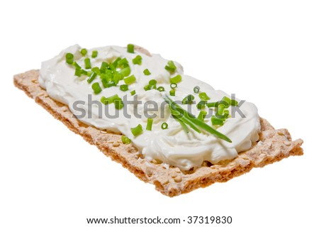 Flat bread with cream cheese and chive topping.  Isolated against a white background.