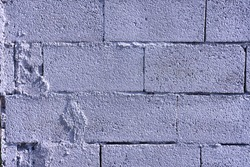 Flat concrete block wall with cement blotches, background