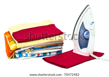 Flat electric iron and clothes isolated on white background