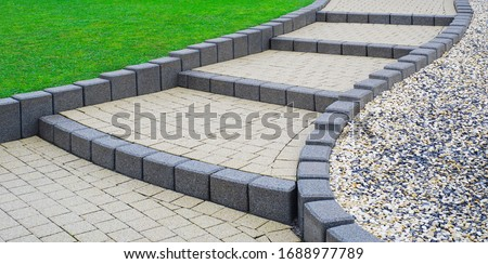 Flat external stairs Garden stairs made of concrete block paving Foto d'archivio ©