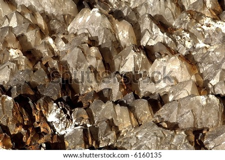 """Flat field of multiple quartz crystals, approximately 12"""" wide x 8"""" deep. - stock photo"""