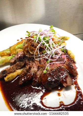 Flat iron steak with fried asparagus #1166682535