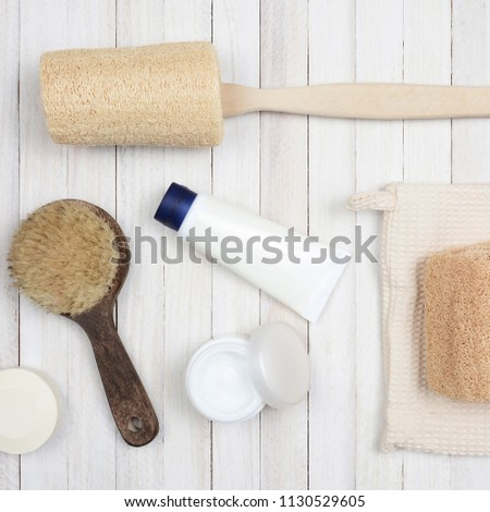 b4fc7b9ccd Flat Lay Bath and Spa accessories on a white wood surface. Items include   luffa