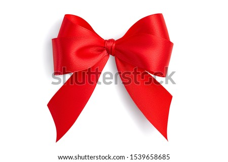 Photo of  Flat lay beautiful red bright four-loop holiday gift bow made of satin ribbon with gray light soft shadow isolated on white background
