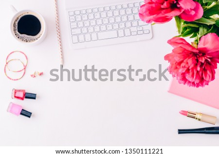 Flat lay blogger or freelancer workspace with a notebook, keyboard, red peonies on a white background #1350111221