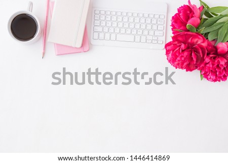 Flat lay blogger or freelancer workspace with a notebook, keyboard, red peonies on a white background #1446414869