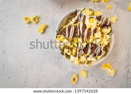 flat lay bowl of chocolate drizzled popcorn