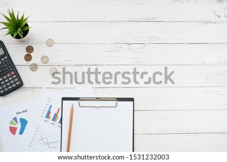 Flat lay business office and finance concept on white wooden table desk with blank paper and analysis document, calculator and coin, Top view with copy space, work space #1531232003