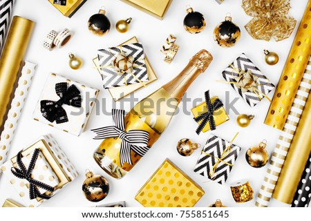 flat lay christmas or party background with gift boxs champagne bottle bows decorations