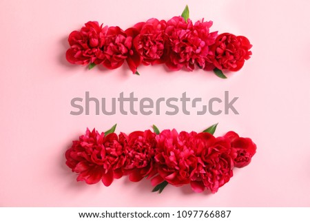 Flat lay composition with beautiful blooming peonies on color background #1097766887