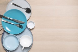 Flat lay composition with beautiful dishware on wooden table. Space for text