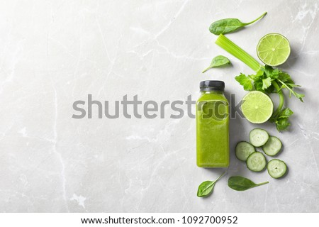 Flat lay composition with bottle of delicious detox juice and ingredients on light background