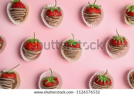 Flat lay composition with chocolate covered strawberries on color background #1126576532