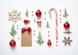 Flat lay composition with Christmas decor on white background