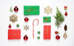 Flat lay composition with Christmas gifts and festive decor on white background