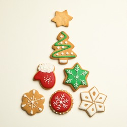 Flat lay composition with Christmas tree made of cookies on light background