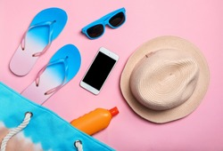 Flat lay composition with collection of beach objects on color background