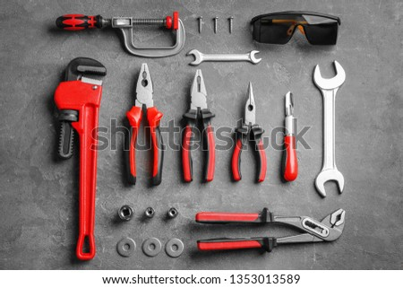 Flat lay composition with construction tools on grey background #1353013589