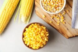 Flat lay composition with corn kernels on grey background