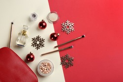 Flat lay composition with decorative cosmetic products on color background. Winter care