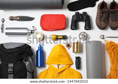 Flat lay composition with different camping equipment on white background Сток-фото ©