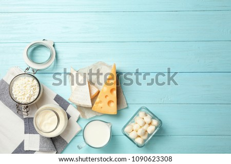 Flat lay composition with different dairy products on wooden background #1090623308