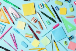 Flat lay composition with different school stationery on light blue background. Back to school