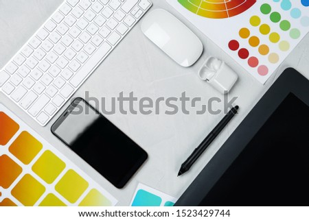 Flat lay composition with digital devices and color palettes on white background, space for text. Graphic designer's workplace #1523429744