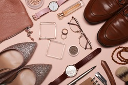 Flat lay composition with fashionable woman's and man's accessories on pink background