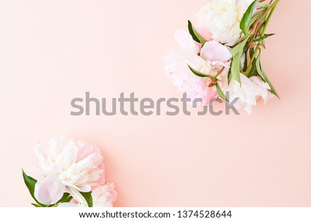 Flat lay composition with light pink peonies on a pink background #1374528644
