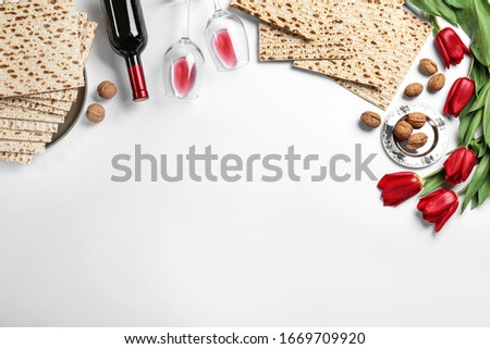 Flat lay composition with matzos on white background, space for text. Passover (Pesach) celebration